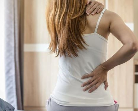 image of female back pain